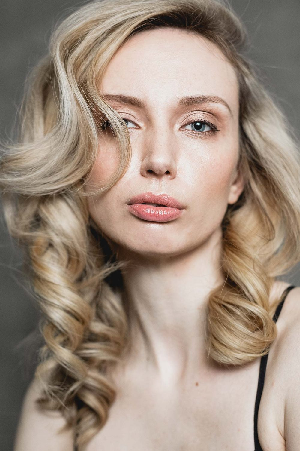 Blonde woman's elegant headshot