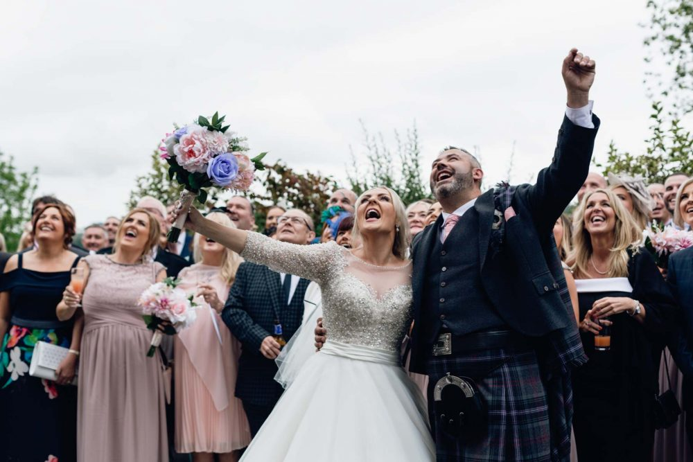 Scottish Couple celebrating their wedding with guests and friends