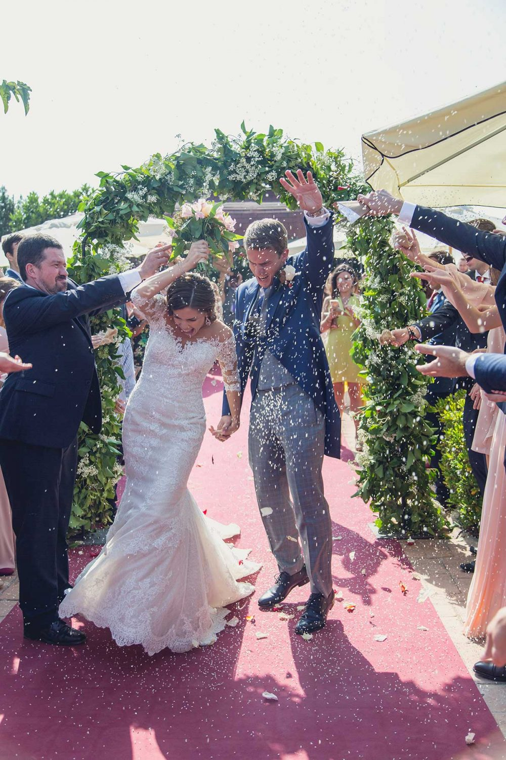 wedding guest throwing rice at the newly weds