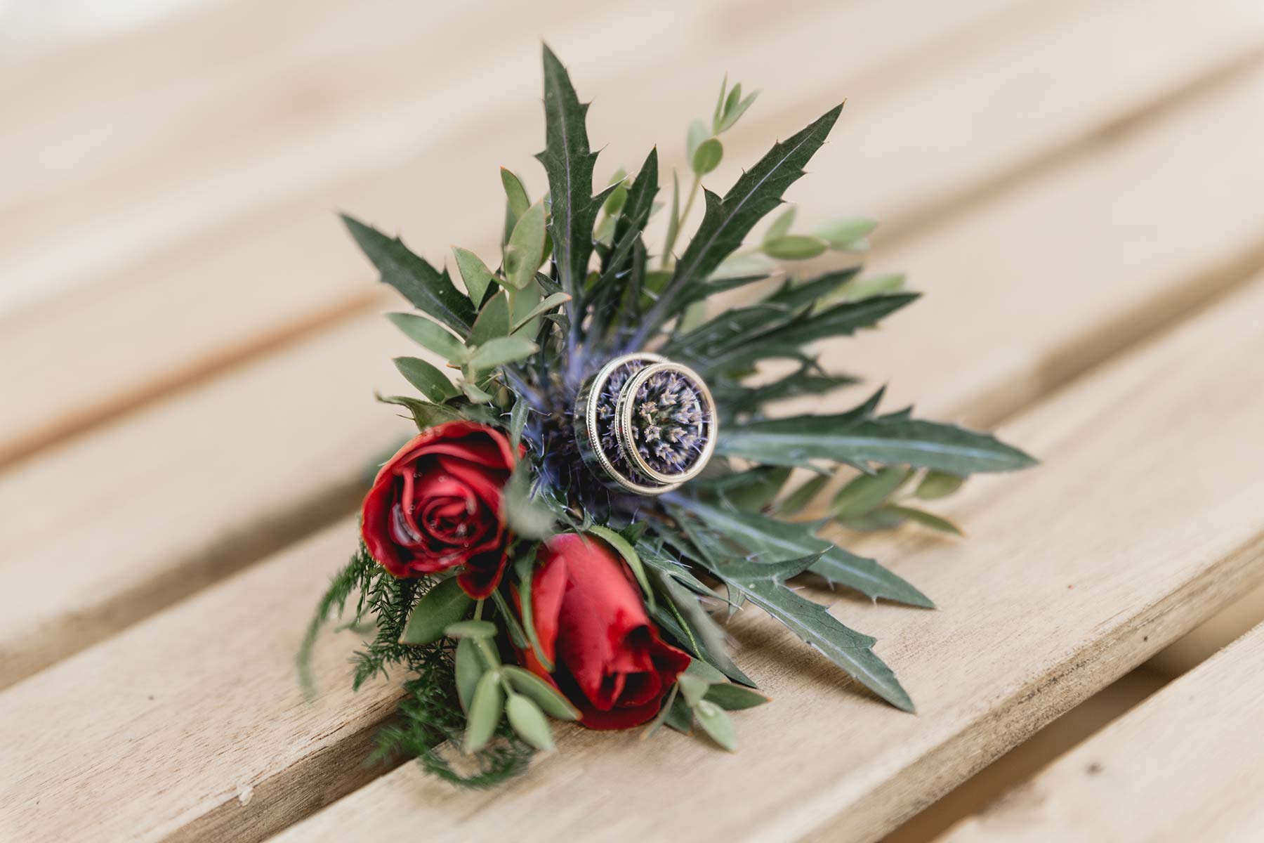 wedding rings stacked on a thistle