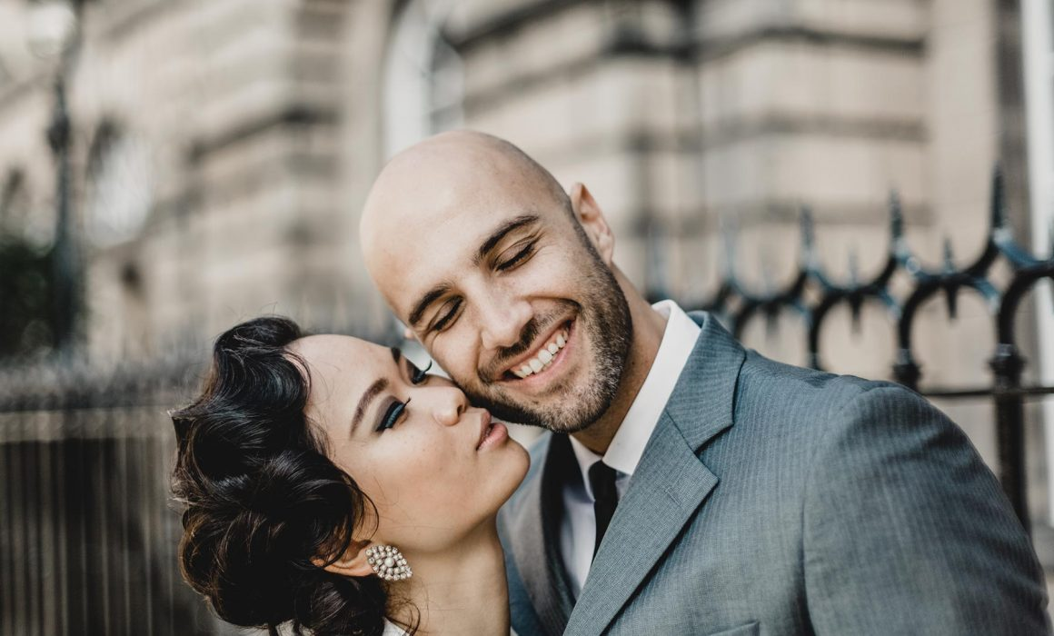 bride kissing her new groom on the cheak